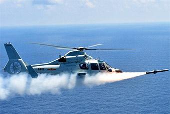 罕见:新型直升机发射机载导弹4发全中