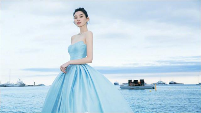 奚梦瑶自拎礼服裙摆过马路 晒海边美照甜美似公主