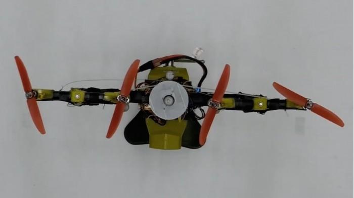 配备两根水平 四轴飞行器可在穿越狭小空间时变形