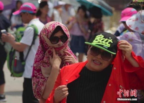 """北京""""烤箱""""模式今日继续 最高气温35℃注意防晒"""