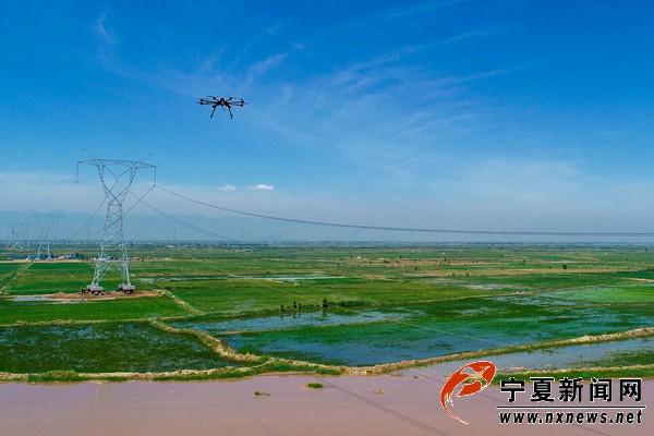 无人机跨越黄河放线,沙湖至上海庙750千伏线路6月底完工