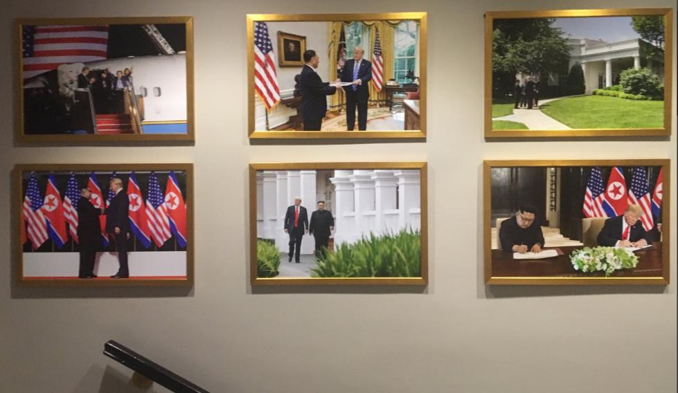 特朗普与金正恩合影挂满白宫走廊 马克龙照片消失