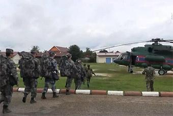 危难见真情:解放军医疗队赴老挝水库溃坝灾区