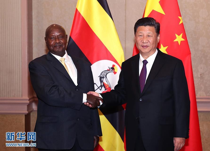 习近平会见乌干达总统