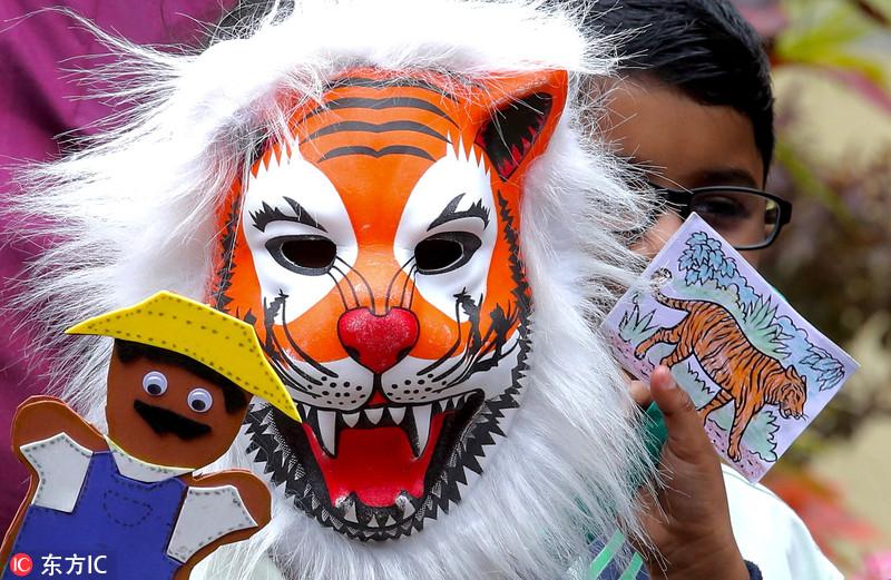 全球老虎日将至 印度萌娃扮老虎呼吁拯救动物