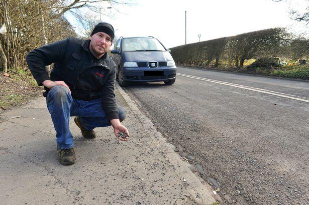 英车主爱车被路面坑洼和碎石损坏 打赢十个月官司