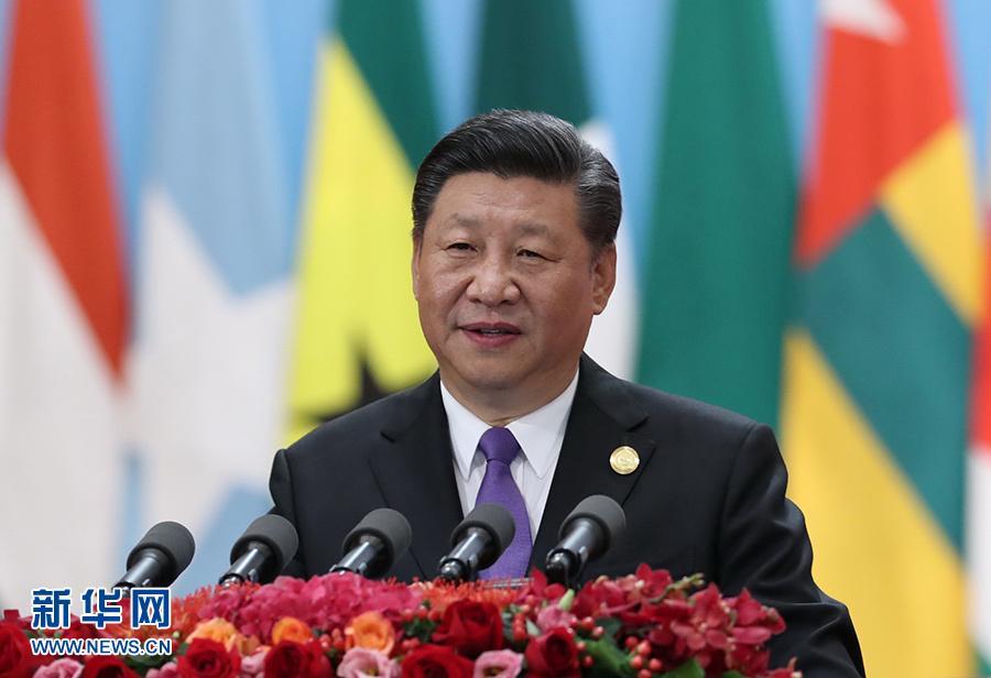 """新华网评:面对时代命题的""""中国担当"""""""