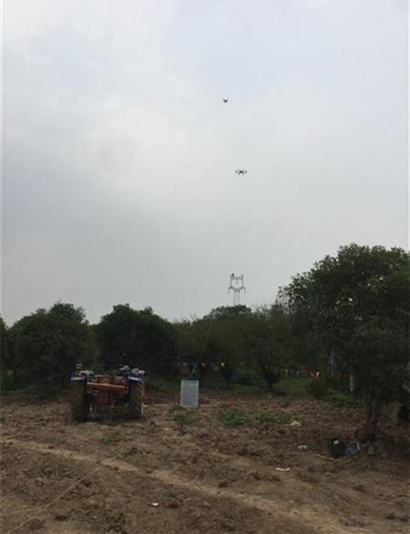 咸宁供电用无人机放线 5.4亩苗圃免遭砍伐