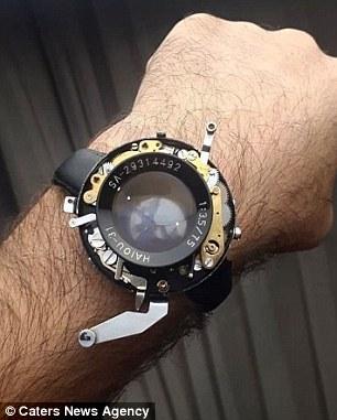 专业摄影师将破损报废的相机改造成智能手表