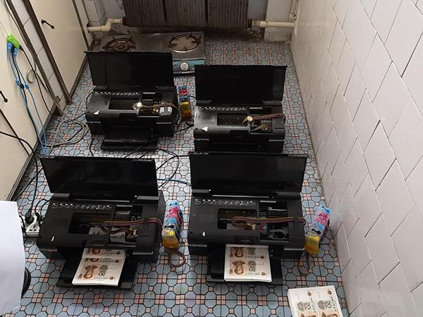 重庆破获网络制售假币案:嫌疑人买打印机制造伪钞120余万