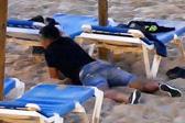 惊人视频曝光西班牙盗窃团伙海滩作案伎俩