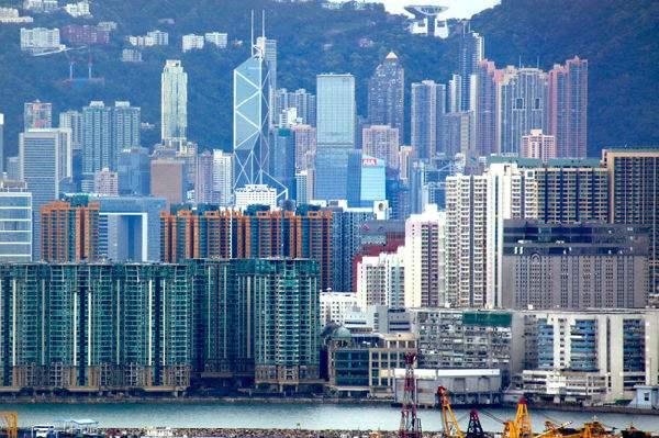 地产股先跌为敬:14年涨4.4倍的香港楼市迎转折点?