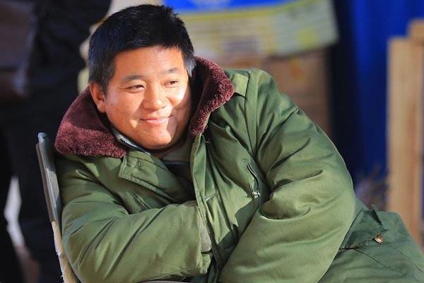 哈尔滨:温度直降8℃ 市民穿起羽绒服大棉袄