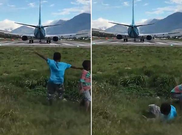 印尼机场两男孩被客机引擎强劲气流掀翻在地