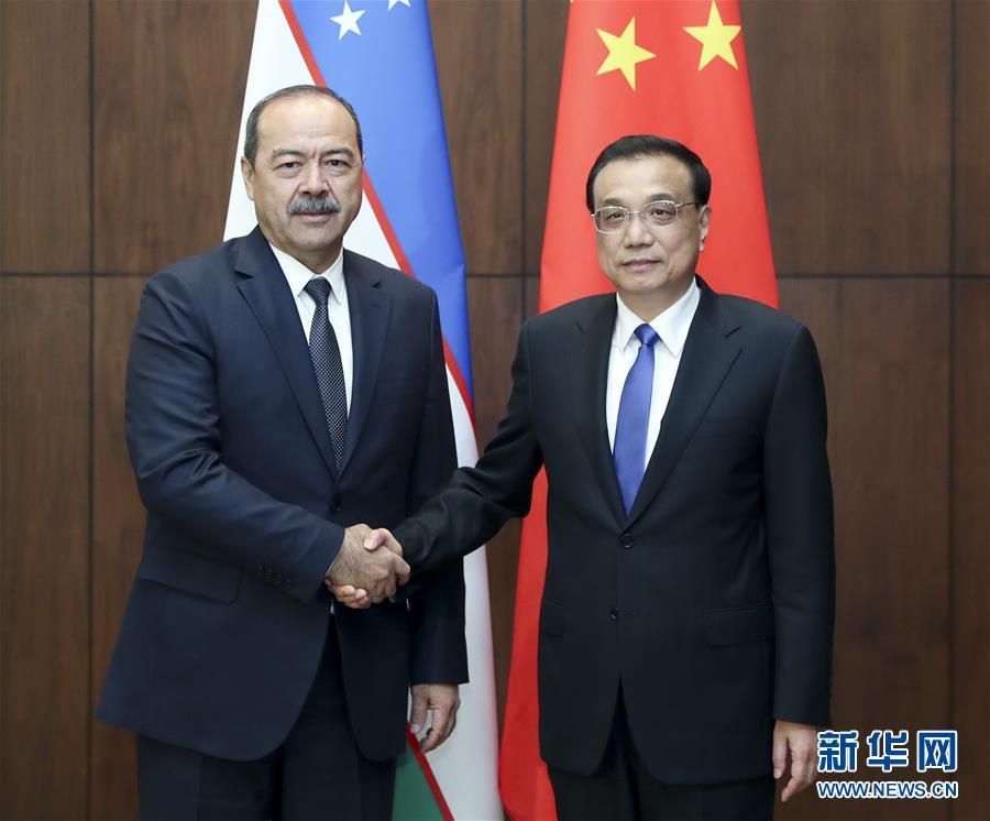 李克强会见乌兹别克斯坦总理阿里波夫