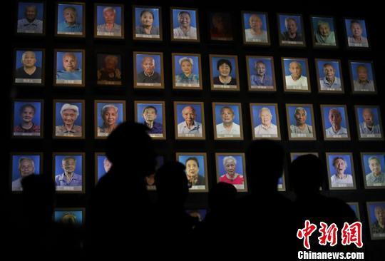 南京大屠杀幸存者熄灯仪式:人证凋零 历史真相永传