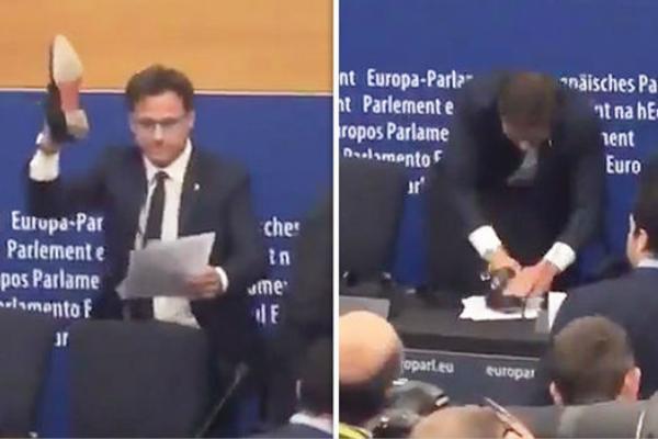 跟歐盟鬧僵!意大利議員當場脫鞋 反復碾壓文件