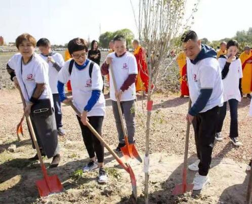 喜迎进博会 上海嘉定发起千人植树护生