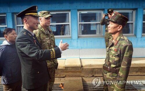 韩朝美开会讨论开放板门店共同警备区