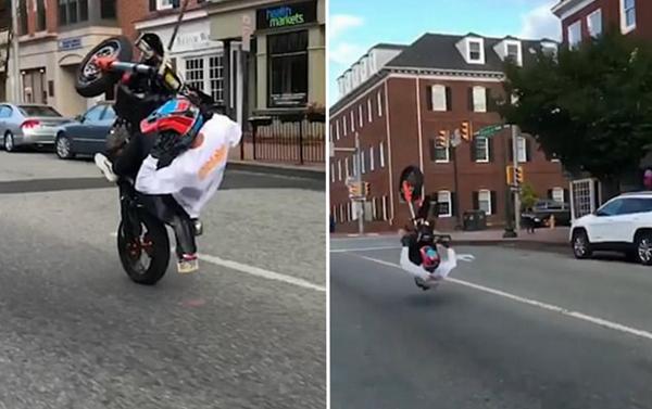 摩托车手抬前轮耍宝失手翻倒 爬起后骑车走人