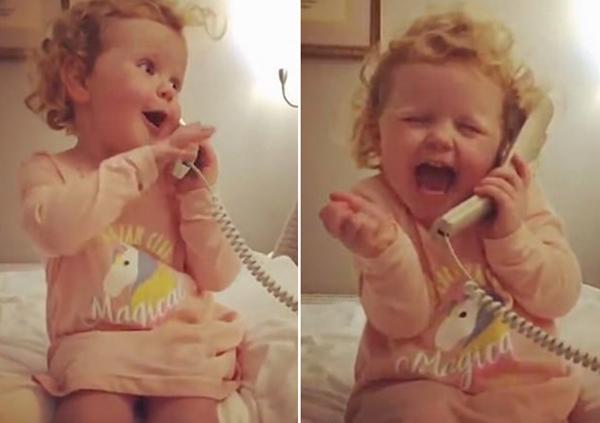 三岁女童与假想朋友通话 表情丰富萌趣搞笑