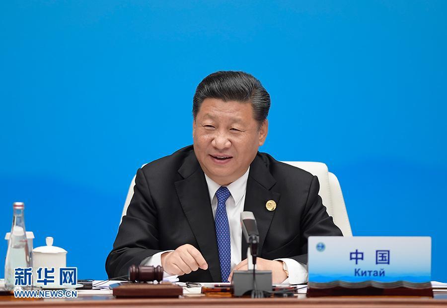 6月10日,上海合作组织成员国元首理事会第十八次会议小范围会谈在青岛国际会议中心举行。国家主席习近平主持。 新华社记者李学仁摄