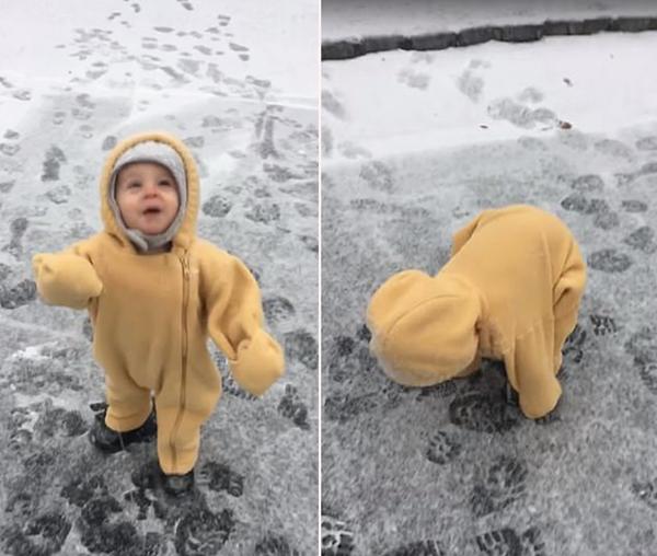 美国一学步男童初见下雪手舞足蹈兴奋不已