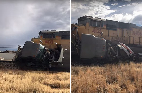 美国一半挂卡车与货运列车相撞被卡铁轨