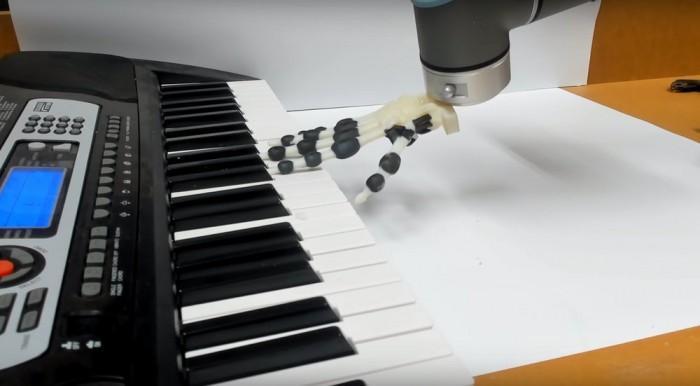 机器人手现可通过摇动和滚动手腕来弹奏简单音乐