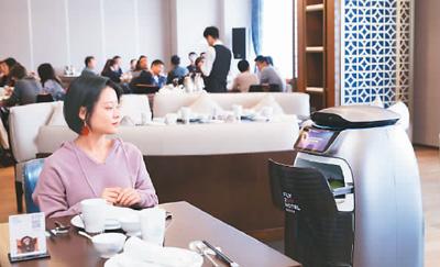 刷脸开房门机器人送餐 阿里首家未来酒店迎客