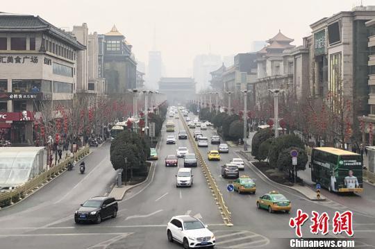 """西安遇""""霾""""启重污染天气红警 机动车限行学校弹性停课"""