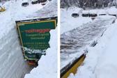 奥地利一卡车强行穿越4米厚雪堆开辟道路