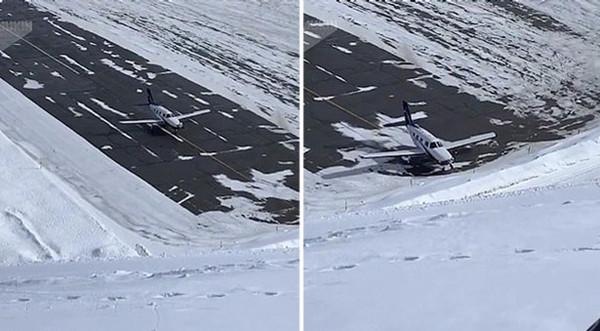 惊!法国一小型飞机在跑道上滑行撞向雪堆