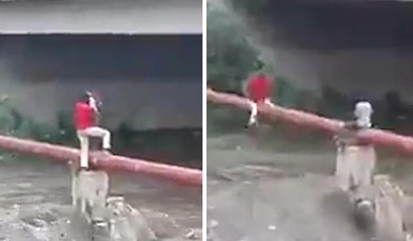南非一男子骑管道勇救被困河上儿童