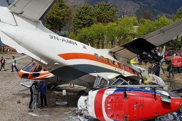 尼泊尔一架飞机冲出跑道撞上两架直升机 致数人死伤