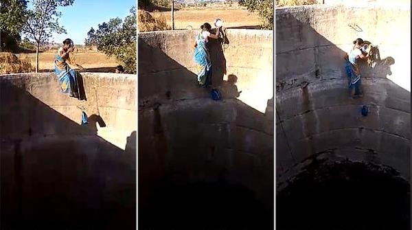 印度一干旱地区妇女徒手爬下18米深水井取水
