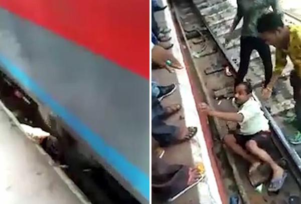 印一男子穿越铁轨突遇火车驶来 俯卧躲过一劫