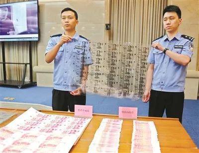 犯罪分子制造的假币和制假币使用的胶片。 广州日报全媒体记者乔军伟摄