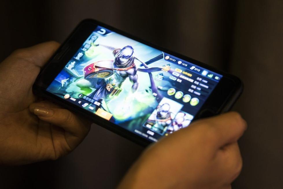 传腾讯游戏向国内各应用店施压:收入分成我要70%
