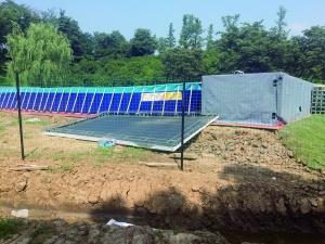 南京龟山公园绿地被毁建泳池 园林局:停工