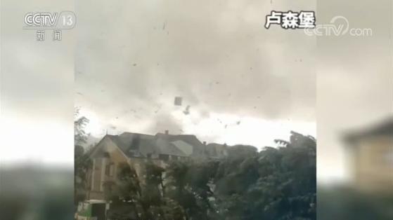 欧洲多国遭遇龙卷风 卢森堡房屋屋顶被吹飞 荷兰出现水龙卷