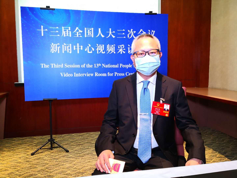 澳区全国人大代表萧志伟:希望澳门多元化发展成金融中心,背靠祖国是最大优势