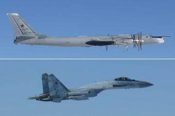 俄军苏35护航轰炸机绕飞日本 日本出动战机拦截