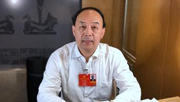 周洪宇:建议实施残疾学生15年免费教育